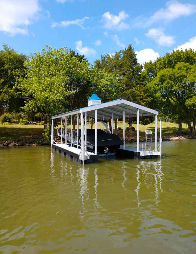 Aluminum Boat Dock on river with boat docking and trees in the background