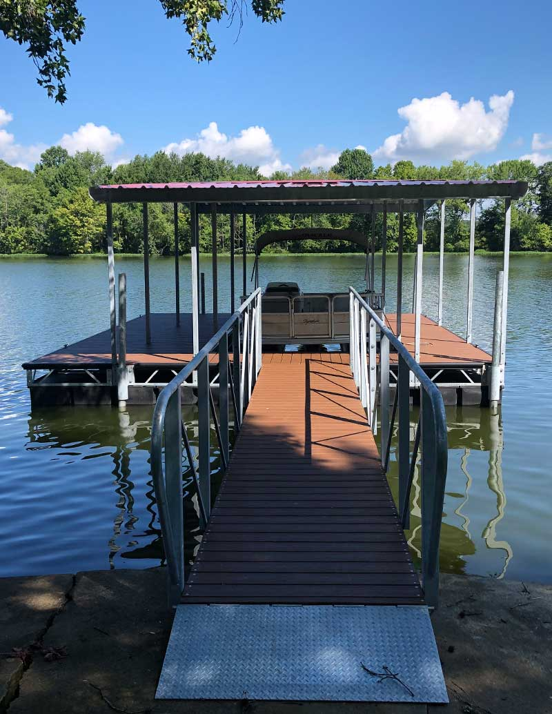 Box Truss Steel Boat Dock floating on the river with trees in the background
