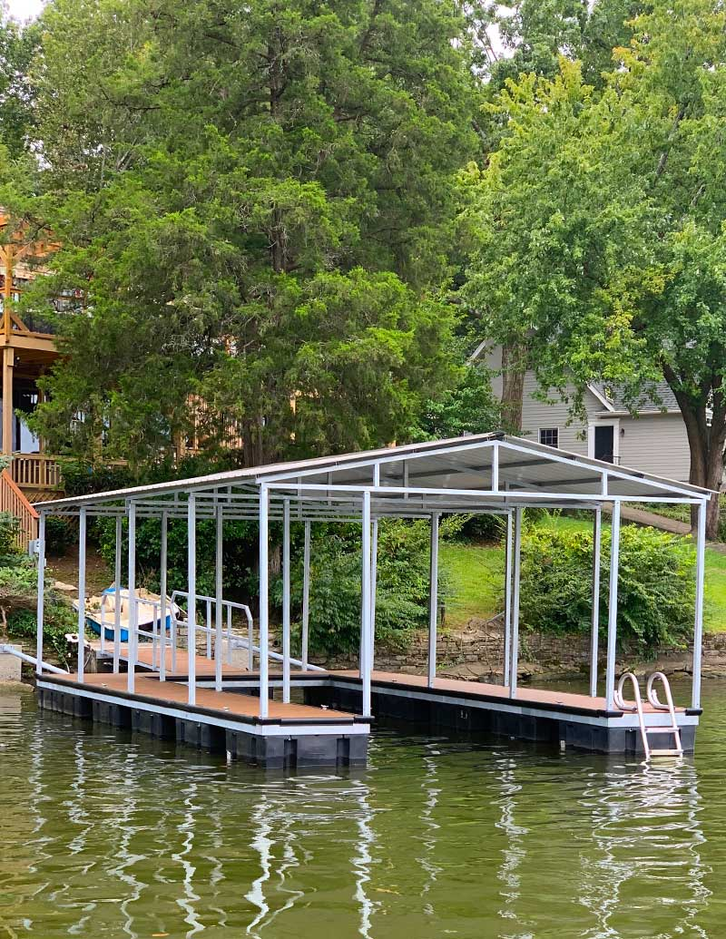 Galvanized Steel Boat Dock on river with room for 1 boat with trees and houses in the background