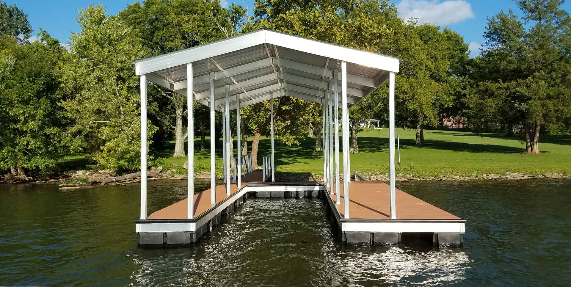 Aluminum boat dock for single boat on river with trees in background