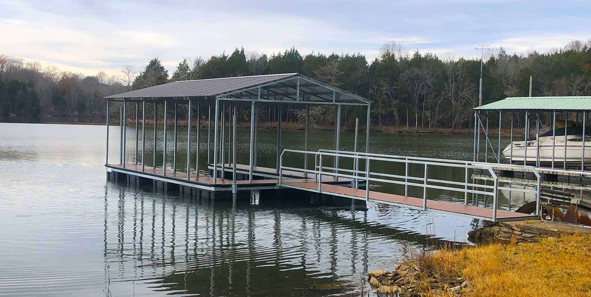 Boat Dock on River with Gangway and trees in background