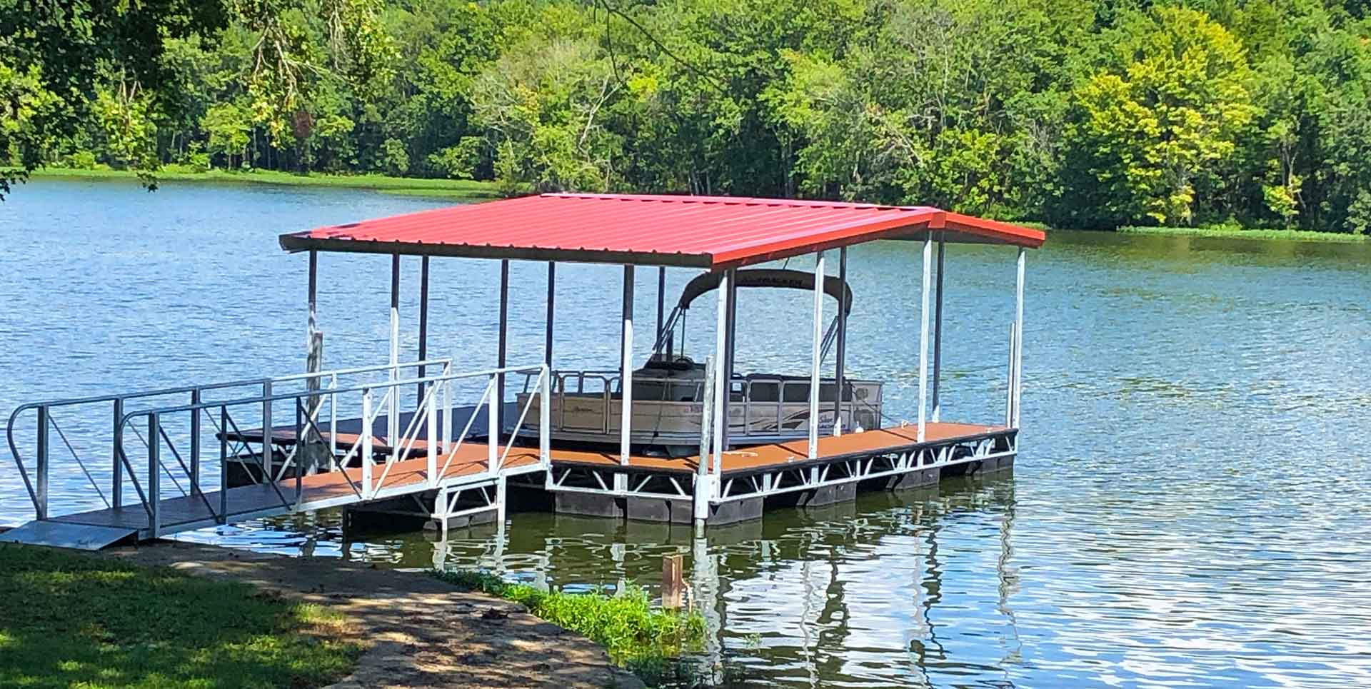 Box Truss Steel dock with red roof on river with trees in background