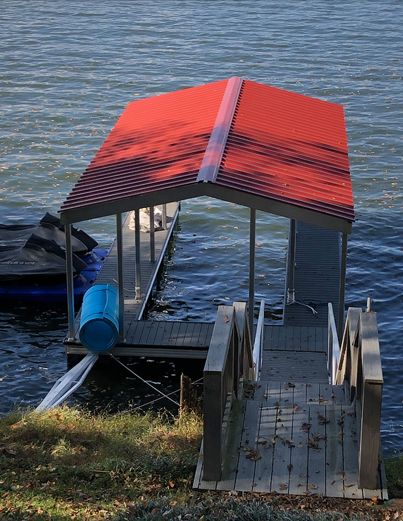 Red roof on boat dock on river