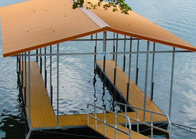 Above view of a gangway leading to a galvanized steel boat dock on river
