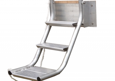 A mockup of a metal dog ladder that has three steps