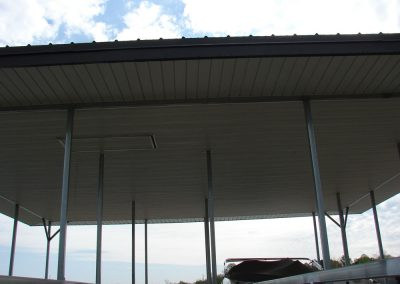 The roof view of an open air boat dock with an access door leading onto the roof