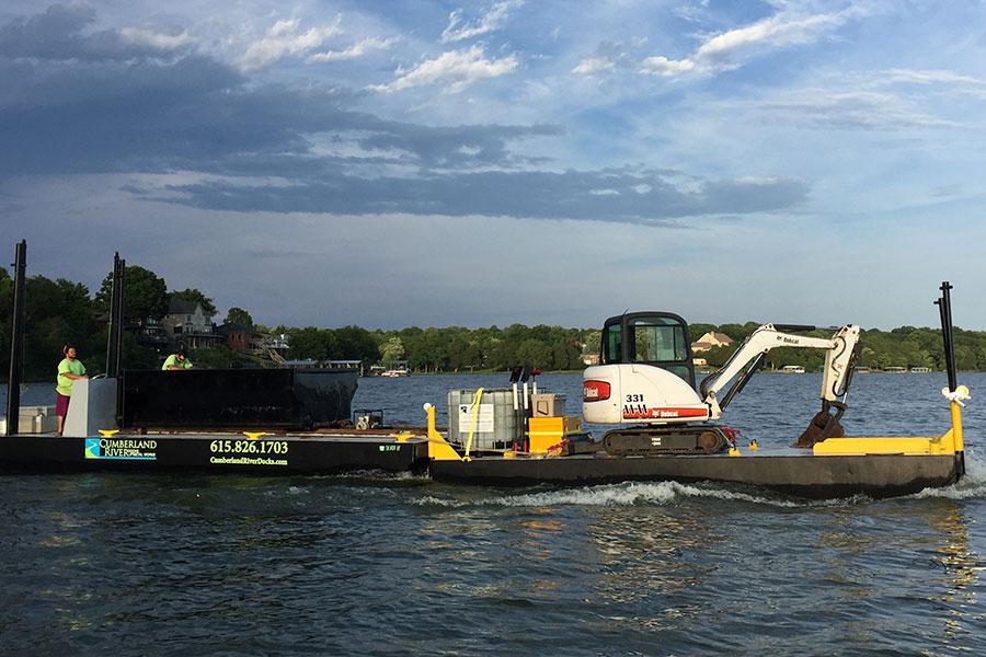 Large barge dredging equipment in lake