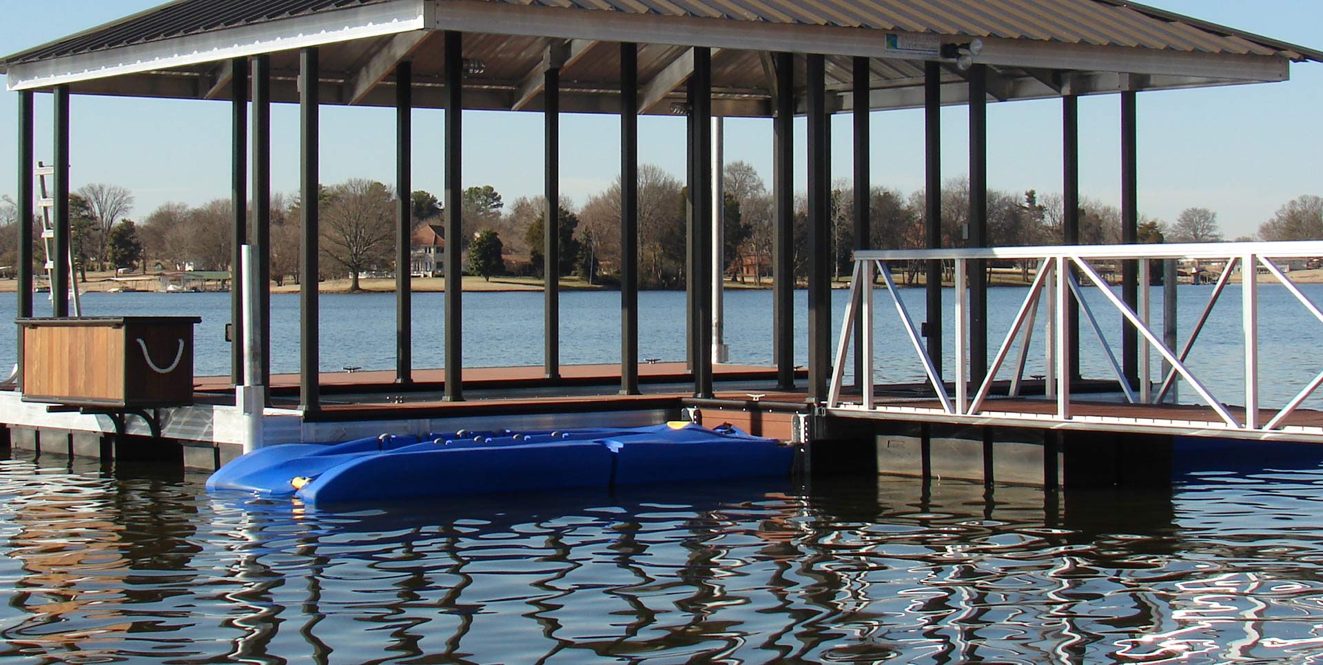 Blue jet ski PWC Lift attached to side of floating boat dock