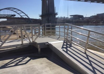 Steel railing along riverfront commercial work