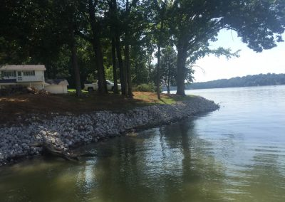 Rip Rap Erosion Control Rocks Along Shoreline of Water