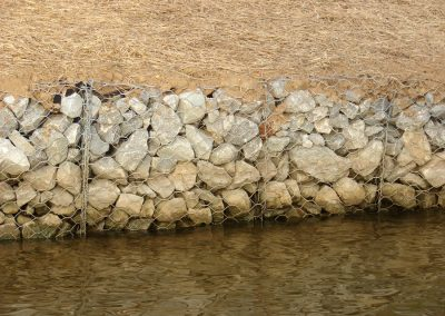 Close up shot of rip rap erosion control rocks on a riverbank
